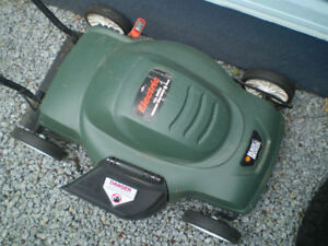 Black and Decker corded electric lawnmower. Polycarbonate body,