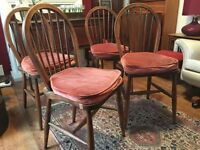 set of 4 Ercol 1944 windor spindle hoop backed chairs stamped 290 with original clip cushions