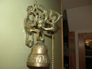 Antique wall mount brass  bell with pull chain.