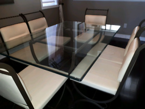 Glass and iron table with 6 cream leather and iron chairs