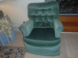 Upholstered, tufted back rocking chair. $20 250-246-3737