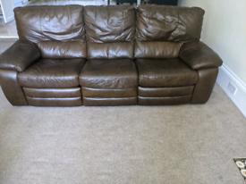 Four seater brown leather sofa