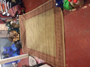 Two rugs small one $10 large one $50