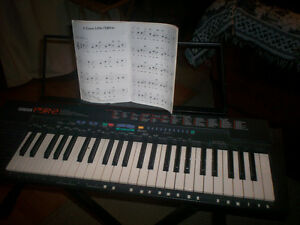 Yamaha PSR-2 with stand.