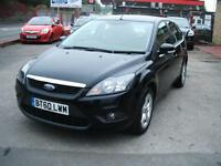 Ford Focus 1.6 ( 100ps ) Zetec 5dr in factory black.tel 01656 724800.