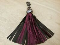 Mulberry leather bag charm in a stunning metallic Mulberry with gunmetal hardware.