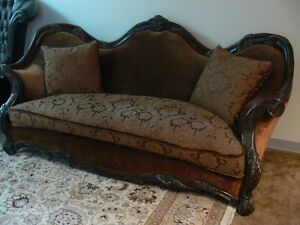 hand carved wood-- michael amini couch