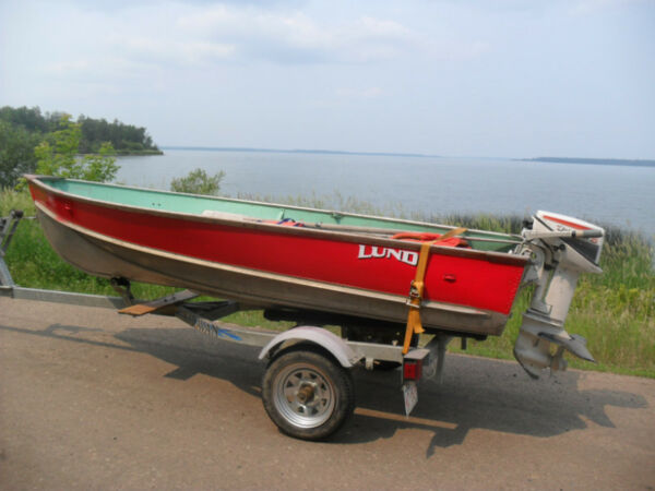 Used 1980 Starcraft 12ft Lund aluminum fishing boat, 7.5hp , Karavan t