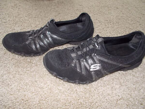 Skechers black running shoe with silver trim London Ontario image 1
