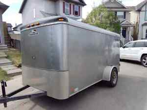 Excellent condition 6x12 Enclosed Cargo Trailer with upgrades.