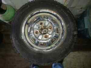(REDUCED)  4 new Snow Tires mounted on used Honda 4 bolt rims.