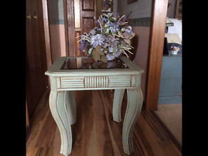 Side table with bronze tone beveled glass insert