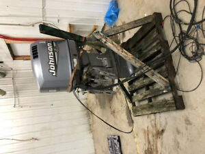 150 hp Johnson outboard motor and controls