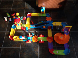 Go go smart wheels train station playset and 8 addition vehicles St. John's Newfoundland image 2