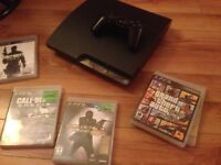 PS3 SLIM SYSTEM, 2 CONTROLLERS, 5 GAMES, ALL WIRES