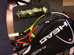 Two tennis racquets and four tennis balls