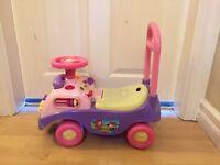 Pink push along/sit on plastic car