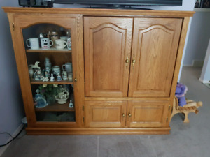 Entertainment cabinet/armoire with solid oak finishings.