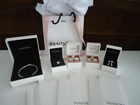 Authentic Pandora Sterling Silver Bracelet and Charms.