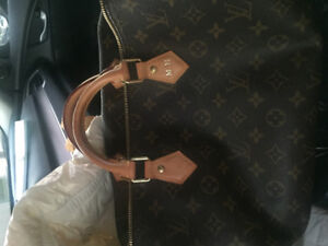Louis Vuitton and a Chanel purse both for sale each $ 900 ,$500