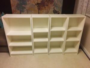"Set of 4 white Ikea Billy bookcases, 42"" tall"