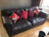 Two seater and three seater brown leather sofas