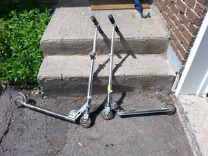 Two foldable scooters