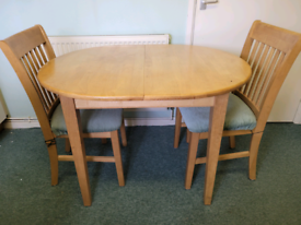 Oval extending pine table and chairs set