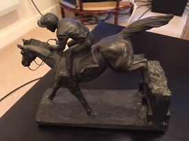 Horse and jockey table statue