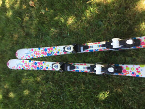 Girls skis and poles