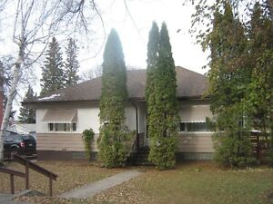 REDUCED $20,000.00!!!   West Hill Home with suite in basement