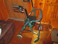 FOLDING WALKER WITH BRAKES AND SEAT.