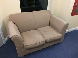 Beige small 2 seat sofa