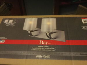 Two brand new light fixtures  side mount