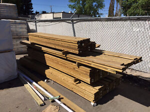 Clearance Green Pressure Treated Fencing and Decking Material