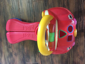 FISHER PRICE WALK AND RIDE TOY