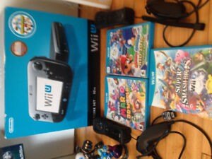 Wii U Deluxe set 32GB with 3 Controllers, 2 nunchuck, and 3 game