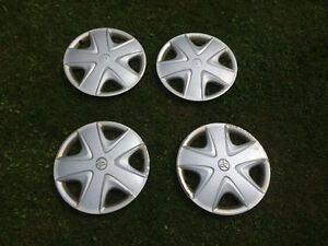 Four 15 inch Toyota Hubcaps
