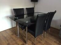 LOVELY GLASS DINING TABLE WITH CHAIRS