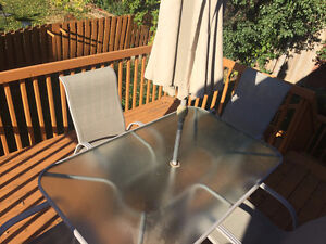Outdoor table with 4 chairs and a big umbrella Peterborough Peterborough Area image 3