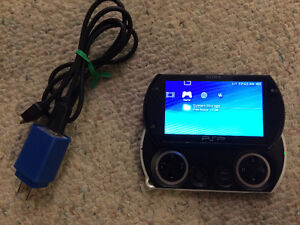 Sony PSP Go 16 gb PERFECT WORKING CONDITION + 2 Games + Charger