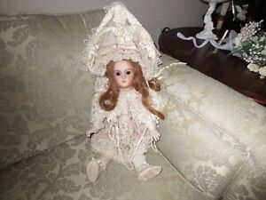 victorian doll dressed in all silk all hand made