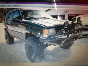 1995 jeep grand Cherokee orvis edition lifted on 33s (saftied)