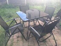Metal 4 seater garden dining table and chairs with umbrella