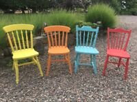 Four farmhouse style chairs painted with Annie Sloan