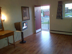 BACHELOR APARTMENT - Utilities Included - From $560/Month