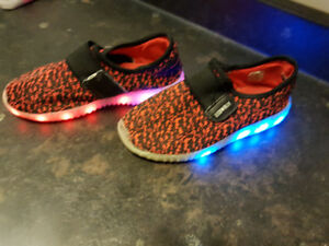 girl and boy lights up shoes