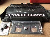 NEW - Yamaha EZ-220 Portable Keyboard ( plus new case )