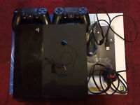 Boxed ps4 with 4 games, 2 controllers and all leads.