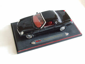 Collectible black car model on display stand